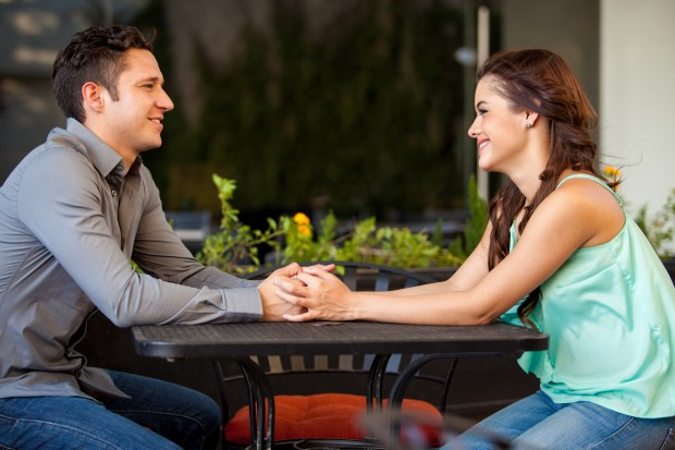 Couple Looking at Each Other Across Table